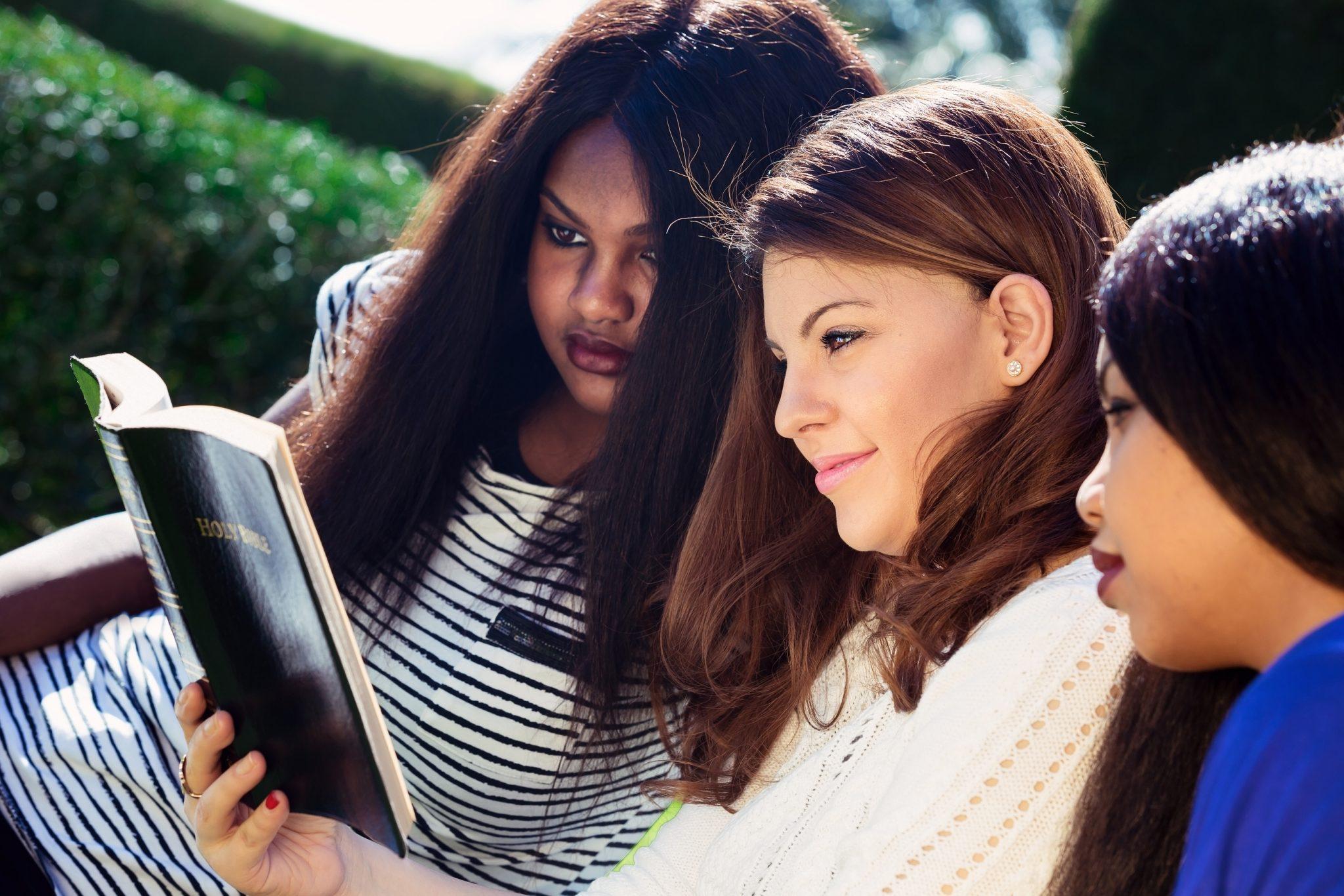 bigstock-Three-Girls-Studying-The-Bible-70361500
