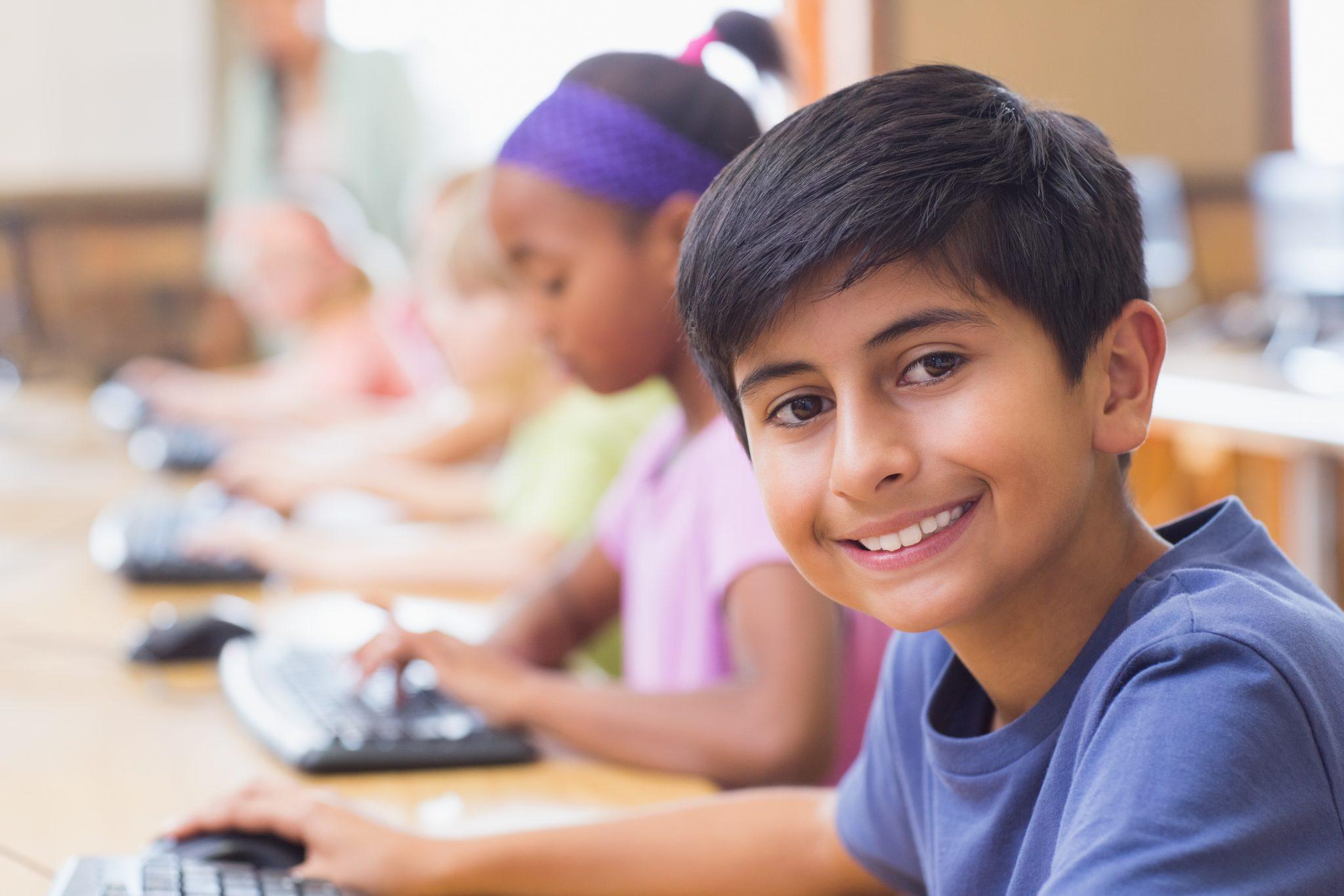 bigstock-Cute-pupils-in-computer-class--85244132